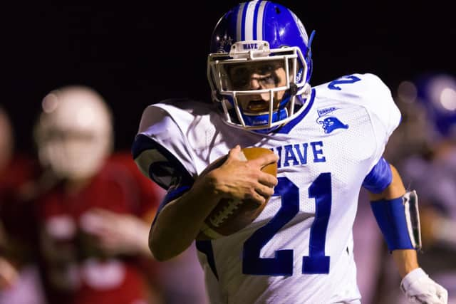 Darien's Shelby Grant ran for two touchdowns to help the Blue Wave beat Greenwich on Friday.