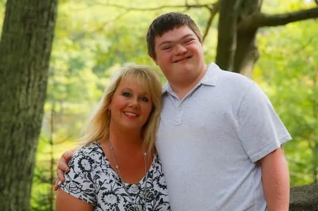 Danbury Realtor Kim Gifford, left, with her son, Peter, says raising a child with Down syndrome has had a profound positive impact on her life.
