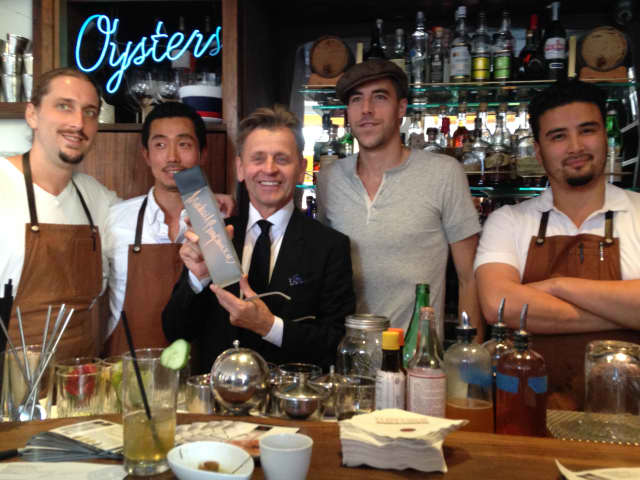 Mikhail Baryshnikov poses with the mixologists who created drinks in his honor using Slovenia vodka.