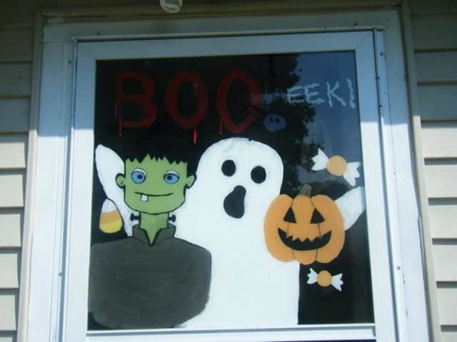 Halloween art will be mounted on storefront windows.