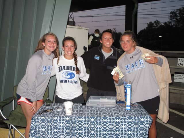 Blue Wave Swim and Dive Seniors Courtney Ferreira, Mackenzie Coughlin, Emma Jansen and Emily Nixon sold tickets to the team's car wash.