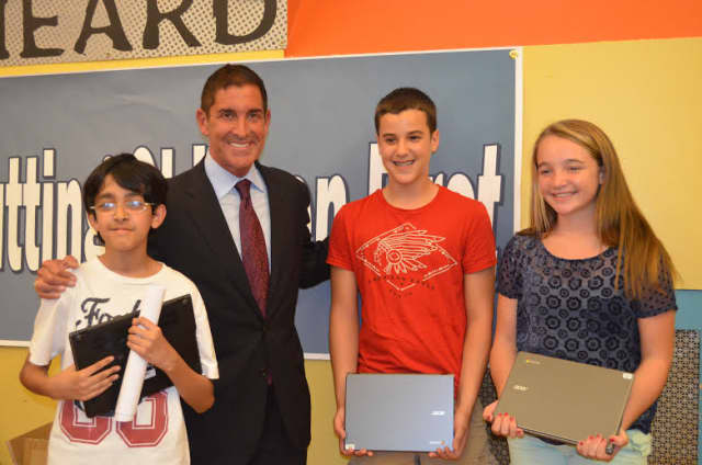 State Sen. Jeff Klein delivers Chromebooks to Pelham students, made possible by a $100,000 grant.