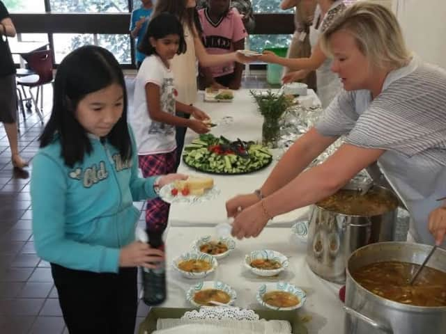Pocantico Hills School fourth-graders harvest vegetables and herbs from their garden for the school's Soup Day.