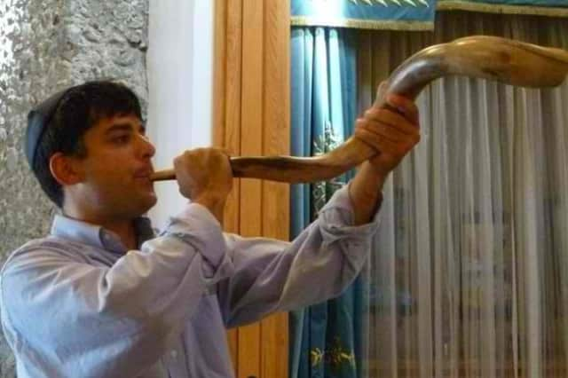 The blowing of the shofar, a Jewish horn used on Yom Kippur
