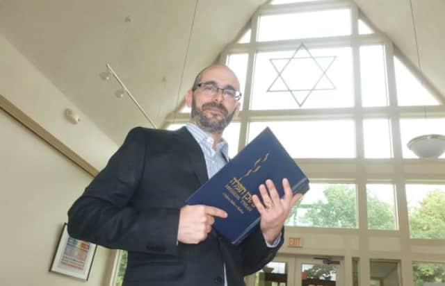 Rabbi Jay TelRav at Stamford's Temple Sinai, stands in the atrium, as he prepares for Yom Kippur.