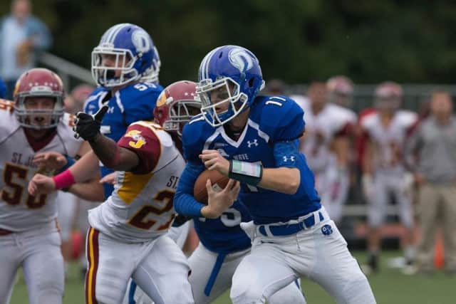 Darien quarterback Timmy Graham runs for yardage against St. Joseph.