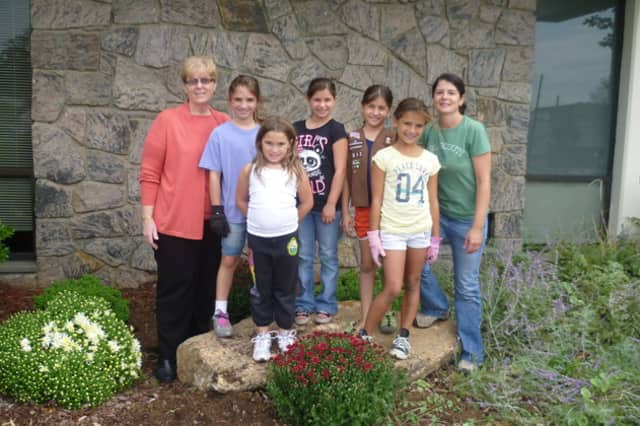 """Eastchester and Bronxville Girl Scouts picked up trash and planted flowers as part of the """"Paint the Town Gold"""" initiative."""