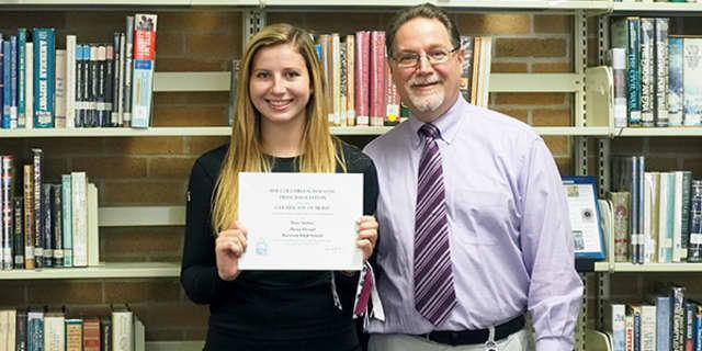 Rose Stokoe and Harrison High School newspaper adviser Gary Glauber.