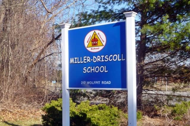 A former aide at the Miller-Driscoll School in Wilton has pleaded not guilty to charges in a child porn case.