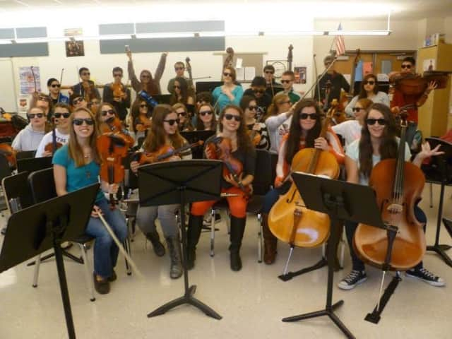 Somers High School's orchestra wears the glasses sold to raise awareness last year on World Vision Day.