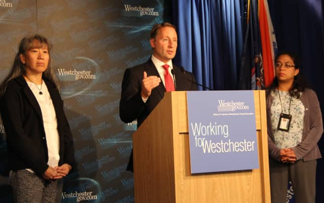County Executive Rob Astorino flanked by Dr. Ada Huang, left, and Dr. Cheryl Archbald, deputy commissioners in the Health Department.