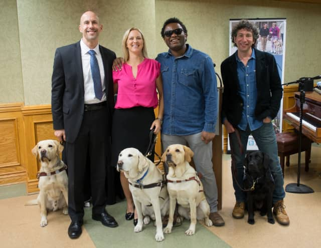 From left, Guiding Eyes President & CEO Thomas Panek with Guiding Eyes Gus, sommelier Amy Dixon with Guiding Eyes Elvis, musician Blessing Offor with Guiding Eyes Jordan and Peter Cole, musician and Heeling Autism parent, with Heeling Autism Madison.