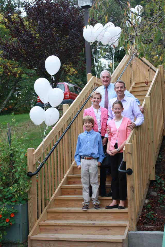 Thomas Gillespie stands with family at the Stair Dedication Center at The Inn, Waveny LifeCare Network's independent living residence. See story for photo IDs.