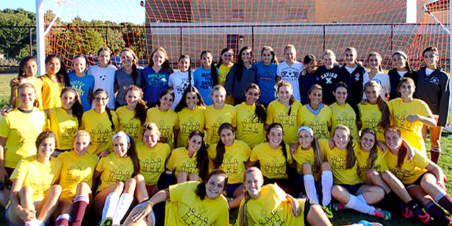 Harrison High School soccer players volunteered in Recipes for Hope.