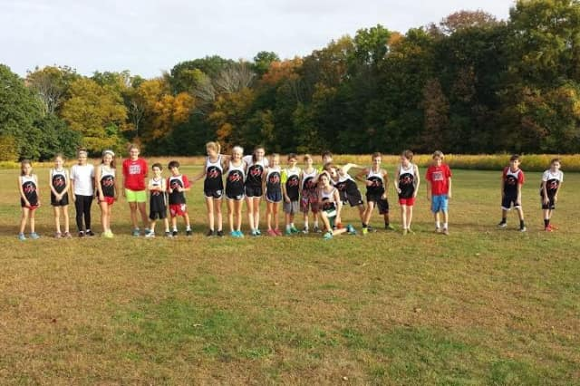 Runners from the New Canaan Blazers youth running team get ready to run in last week's cross country meet against St. Aloysisus and St. Luke's, where they took eight of the top 10 spots.