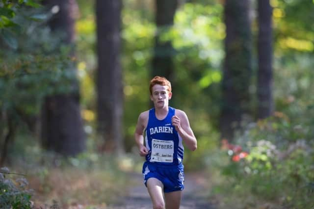 Darien's Alex Ostberg runs away from the field Monday at the Fairfield County Interscholastic Athletic Conference championships. Ostberg announced later in the day he would be attending Stanford University next year.