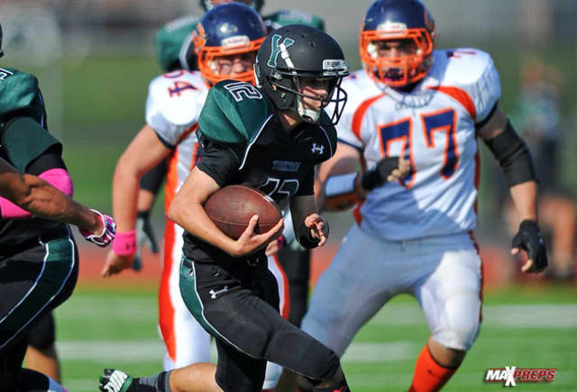 Senior quarterback Ryan Baker gains ground for the unbeaten Yorktown football team.