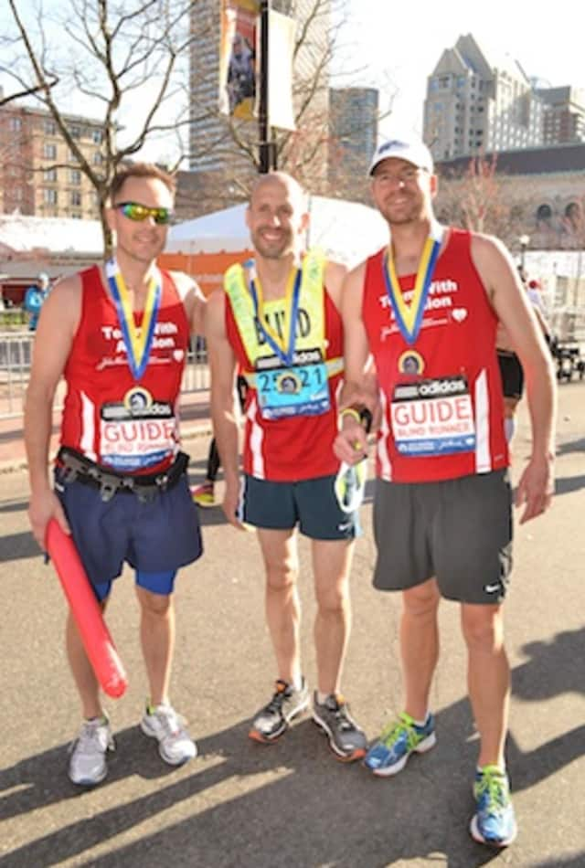Thomas Panek, center, will run in the NYC marathon.