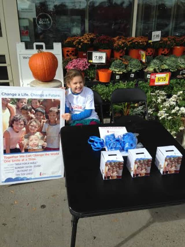 Steven Christofor and his daughter, Isabel, have organized a walk-a-thon in Ridgefield to benefit SmileTrain.