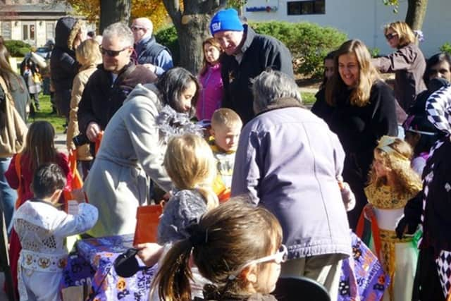 Kids gather candy at a past Wilton Pumpkin Parade and Trick-or-Treating day.
