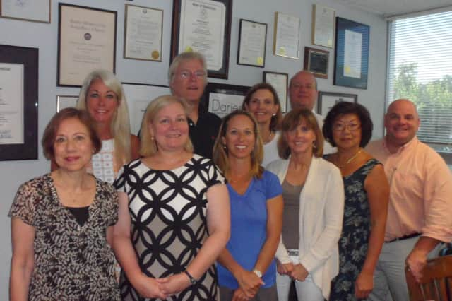 Darien Chamber of Commerce committee members for the wine tasting and auction.