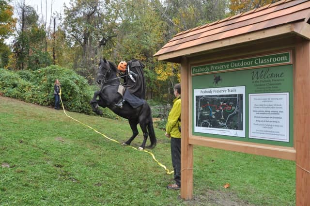 The Headless Horseman helps with the ribbon cutting at the Peabody Preserve Outdoor Classroom.