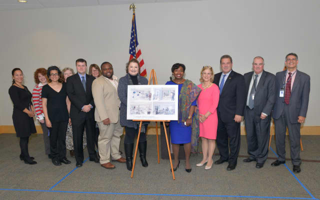 State Sen. Andrea Stewart-Cousins, Assemblymember Shelley Mayer, Yonkers Mayor Mike Spano, Yonkers Public Library Director Stephen Force, Edward Falcone, deputy director of the library, Councilman Christopher Johnson, library staff and trustees