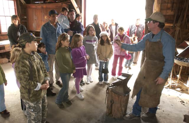 A blacksmithing demonstration at Muscoot Farm.