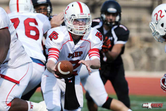 Colton Smith had over 500 yards of offense for Fairfield Prep in a 51-28 win over previously unbeaten Cheshire.
