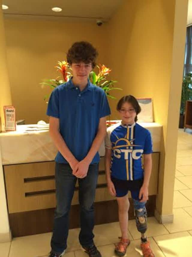 Andrew Day, left, a high school senior, will run the New York City Marathon for the Southport-based Connecticut Challenge. He is shown with Maya Oberstein, who was the co-chair of the Challenge's annual summer bike ride.
