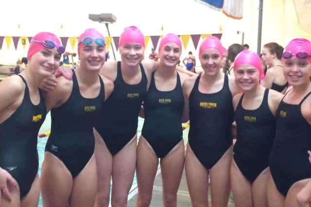 Members of the under-13 Wilton Wahoos girls swim team wore pink caps for the opening meet to support Breast Cancer Awareness Month.