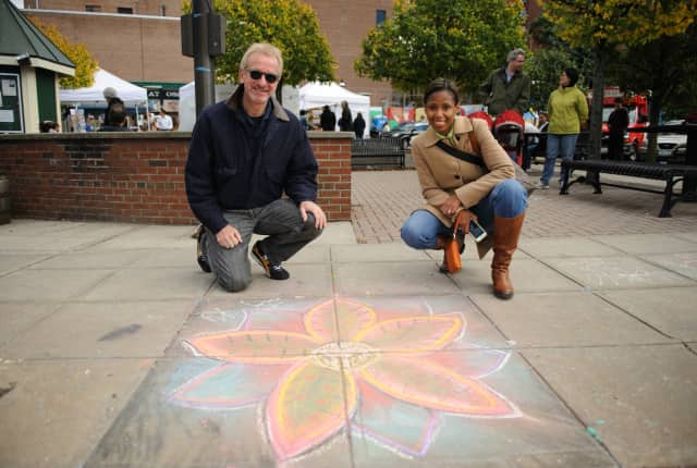 Ossining Village Manager Richard Leins and Ingrid M. Richards, Manager of Downtown & Economic Development, at the Village of Ossining's First Annual Chalk It Up! Festival held recently at Market Square.