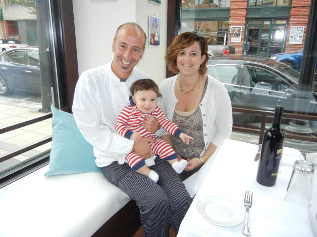 Pasquale De Martino and Jennifer Galletti, owners of Trattoria 'A Vucchella, with their son, Michele.