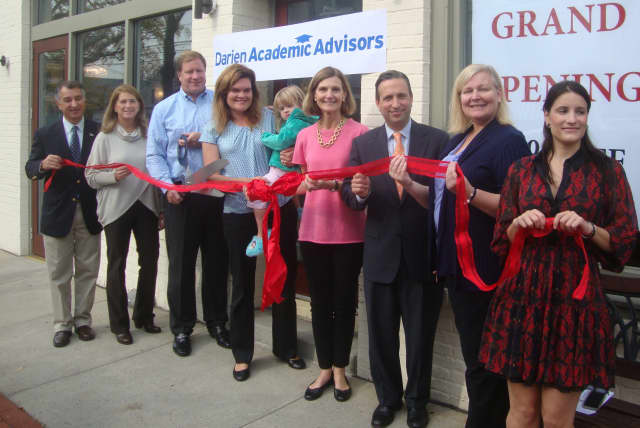 Mike and Kristin White, along with local officials and members of the Darien Chamber of Commerce, cut the ribbon to celebrate the opening of Darien Academic Advisors on Post Road.