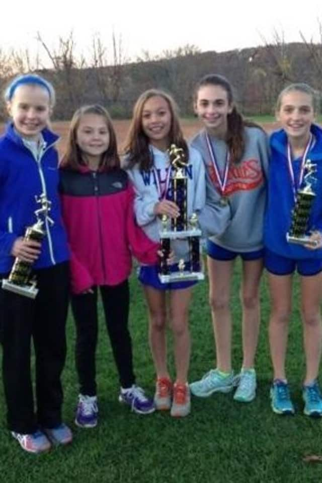 Girls on Wilton Running Club celebrate after winning the conference championship meet on Monday.From left are Angela Saidman, Ashley Nicoletti, Emily Welch, Lauren Klym, Tess Pissanelli and Lily Kealy.
