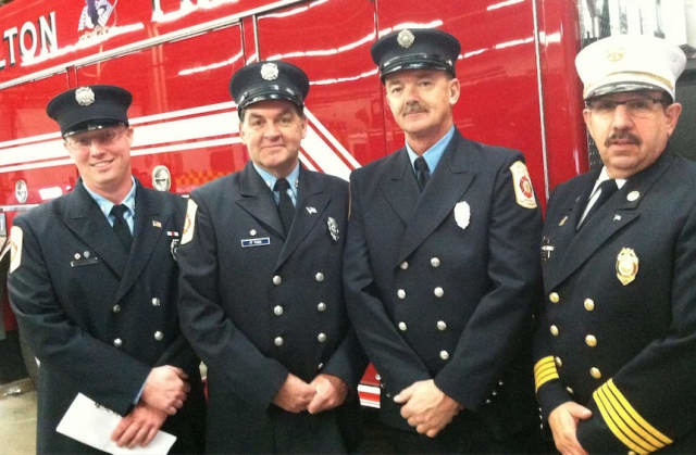 Wilton Fire Department firefighters from left, Brian Elliott, Kevin Plank, Ralph Nathanson and Deputy Chief Mark Amatrudo, Ralph Nathanson, stand in front of Engine 4, the new addition to the department's fleet, following a ceremony Wednesday.