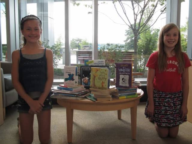 Whisconier Middle School students Emma Beal and Kailee Gunn organized a book drive for pediatric patients at Danbury Hospital.