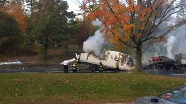 The Greenwich Fire Department puts out a truck fire on the Merritt Parkway.
