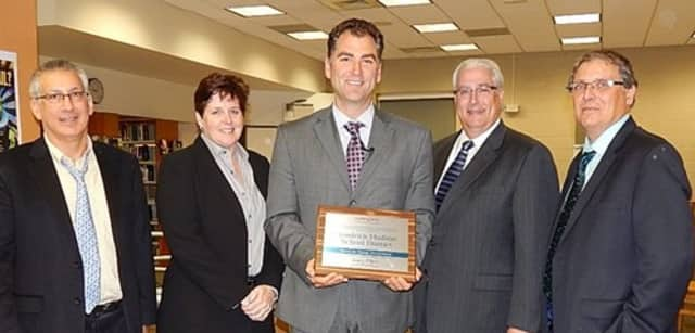 Enrique Catalan, MaryPat Briggi, Joseph Hochreiter, Charles Fasnacht, and Dr. Mathew Swerdloff with the plaque Hen Hud received from Cenergistic.