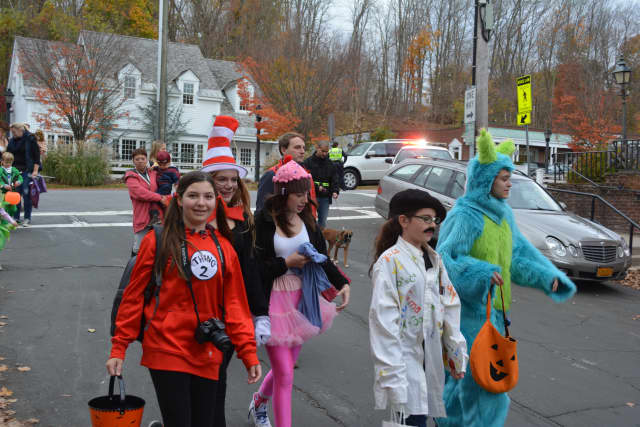 Marchers in a previous Bedford Village Halloween Parade.