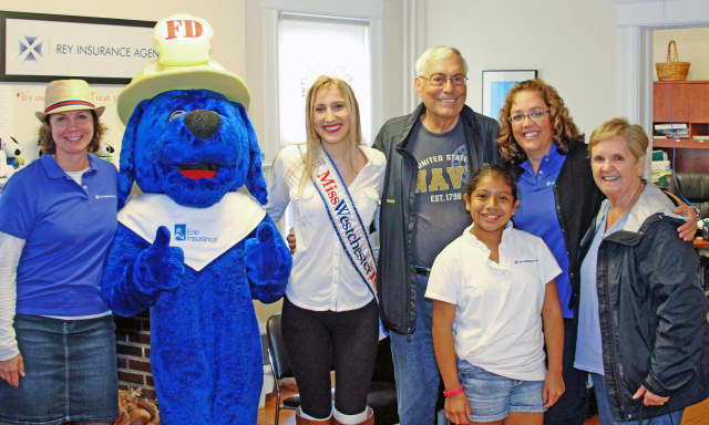 Attendees at Rey Insurance's Child ID Day got to hang out with Ernie the Big Blue Safety Dog.