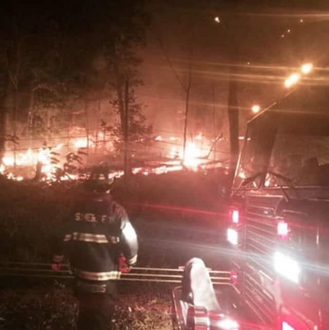 Fire departments from seven municipalities battled the brush fire.