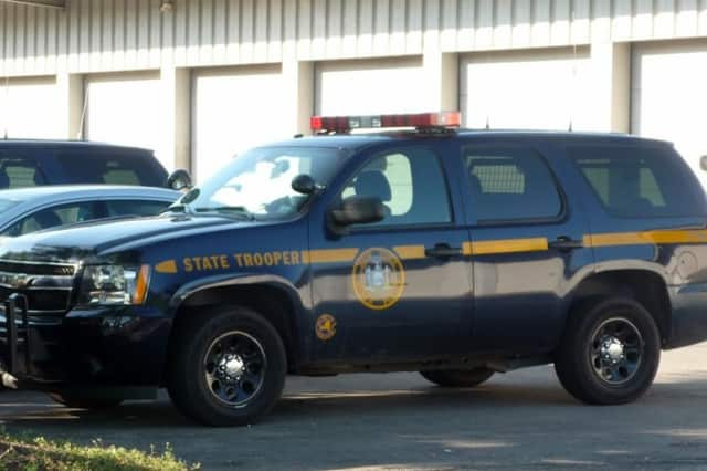 State police charged an 18-year-old with violating an order of protection and trespassing on school grounds.