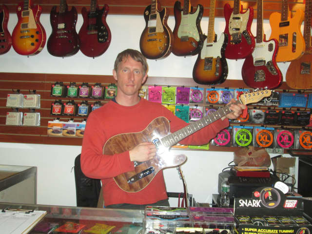 Paul DeCourcey, who recently opened up a guitar shop in Peekskill.