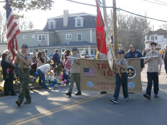 Boy Scouts march in Yorktown's annual Veterans Day Parade.