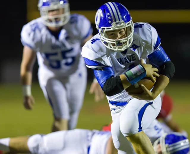 Darien's Peter Archey runs for yardage during a game earlier this year.