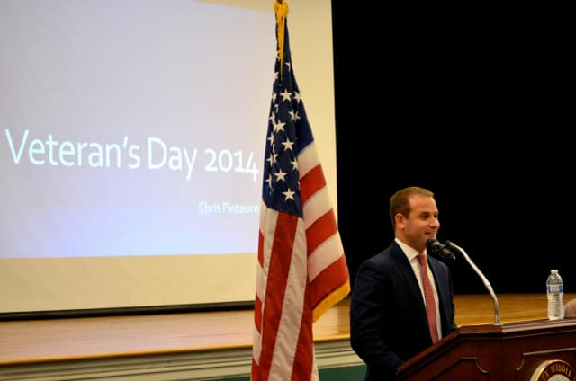 Navy pilot and former Middlesex student Chris Pintauro shares his military experiences during the Middlesex Middle School Veterans' Day celebration this week.
