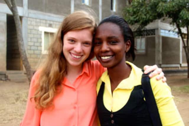 Mary Grace Henry with a student in Africa.