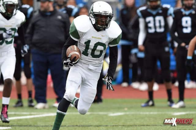 Miguel Lanier and Woodlands play in a Class C playoff game Saturday at Mahopac High School.