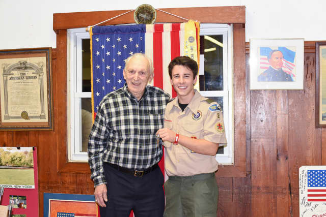 Zak Armacost (right) hands over the keys to Admiral Farragut Post 1195 to Post Commander James Pasanello